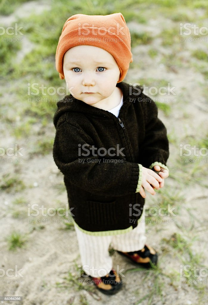 toddler wearing orange hat outside royalty-free stock photo