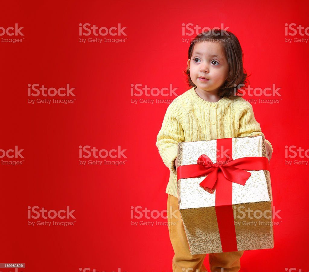 Toddler with a christmas gift royalty-free stock photo