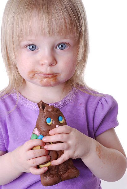 Toddler With Easter Bunny Chocolate on Her Face stock photo
