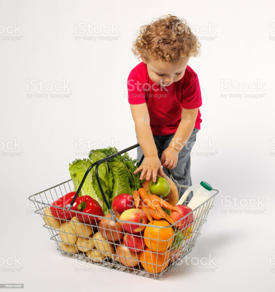 Toddler with Fruit and Vegetables in a Basket royalty-free stock photo
