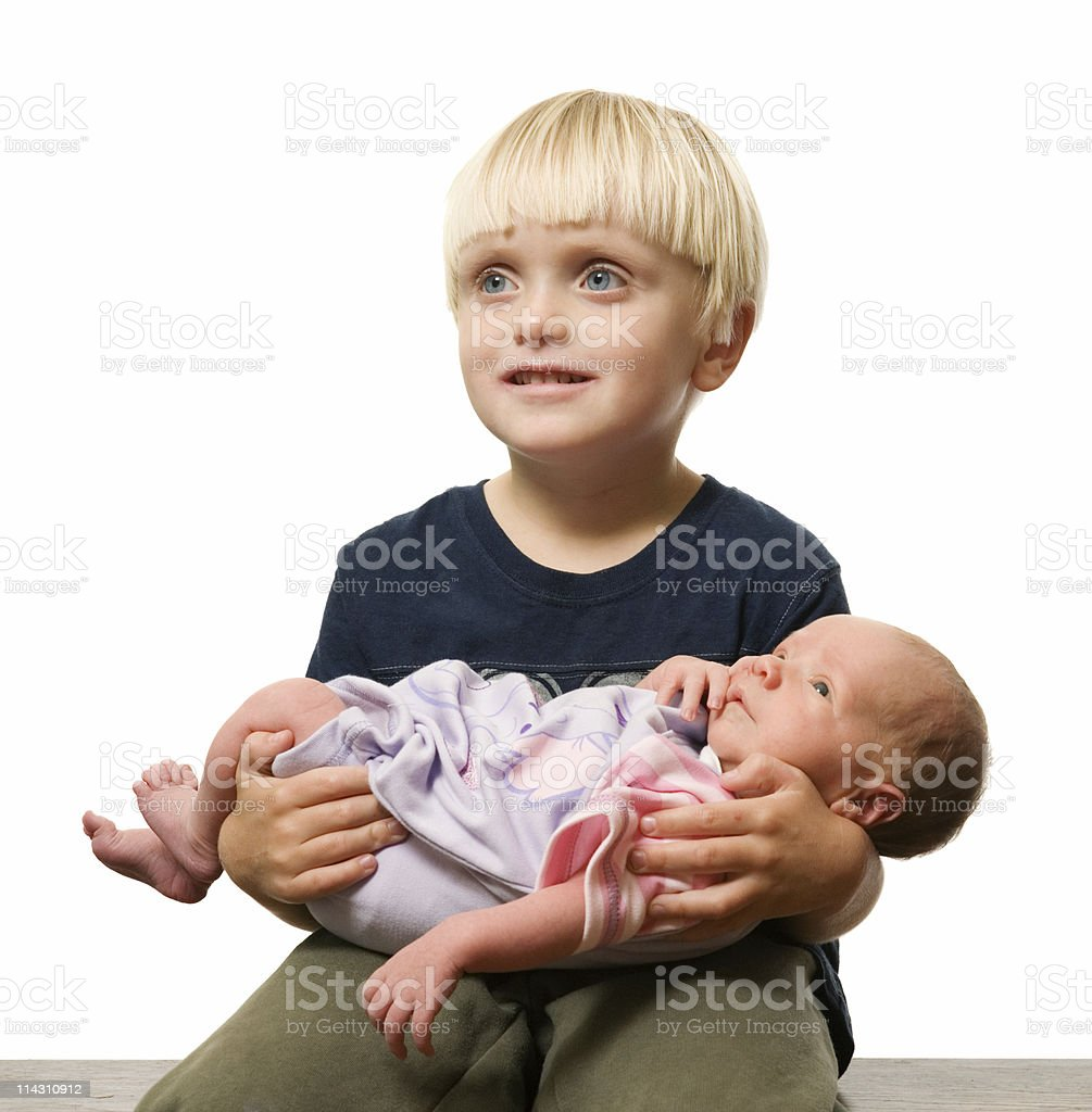Toddler with newborn sister royalty-free stock photo