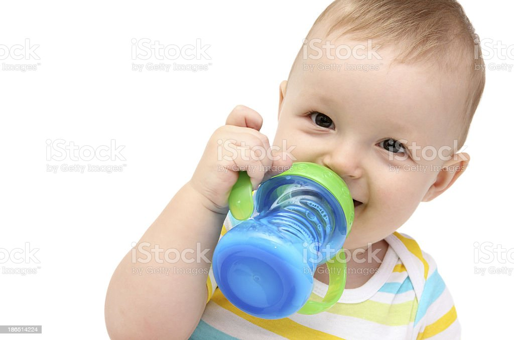Toddler with sippy cup and milk royalty-free stock photo
