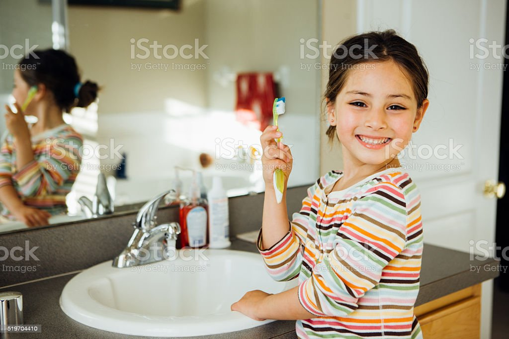 Toddler with toothbrush stock photo