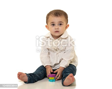 667590810 istock photo Toddler with Wooden Shape Toys 1049553844