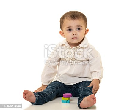 667590810 istock photo Toddler with Wooden Shape Toys 1049553850