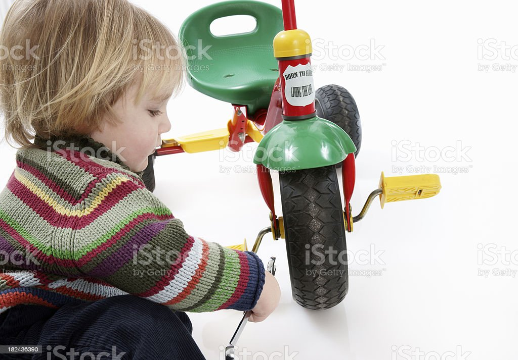 Toddler working on his bike royalty-free stock photo