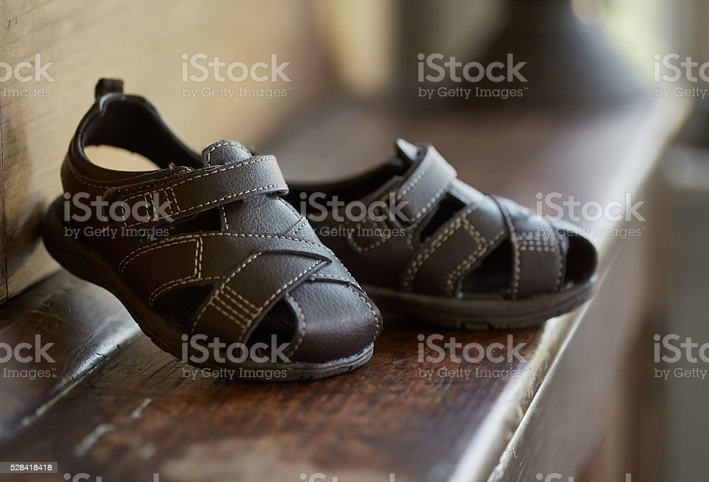 Toddlers leather sandals stock photo