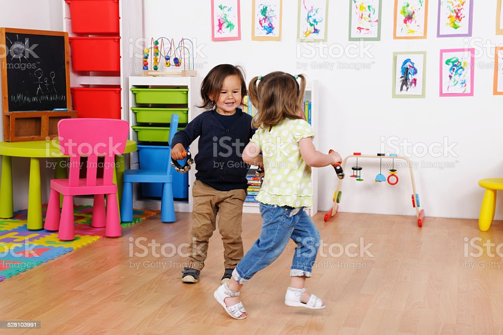 Toddlers/ Little Children Enjoying Music And Dance At Nursery stock photo
