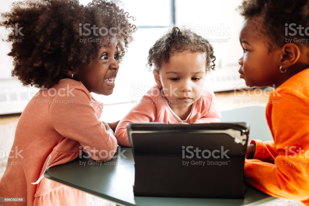 Toddlers watching educational video stock photo