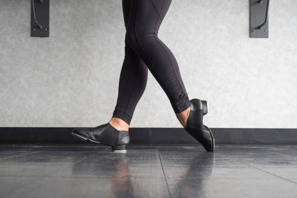 Toe Heel stand in tap shoes during dance class stock photo