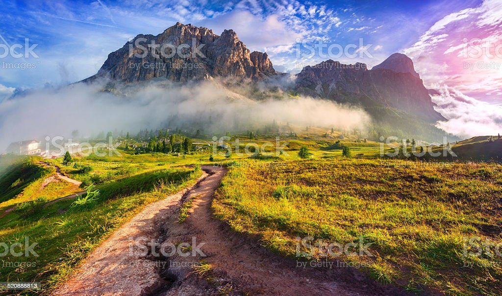Tofane mountain range at sunny foggy morning. stock photo