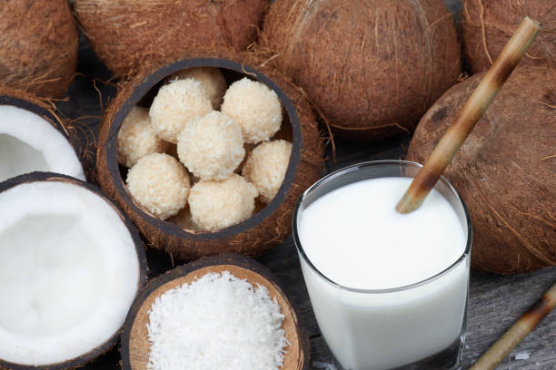 Toffee and coconut sweets and coconut drink stock photo