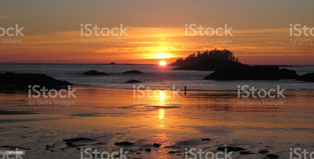 Tofino Sunset at Low Tide, Islands, Person in Silhouette stock photo
