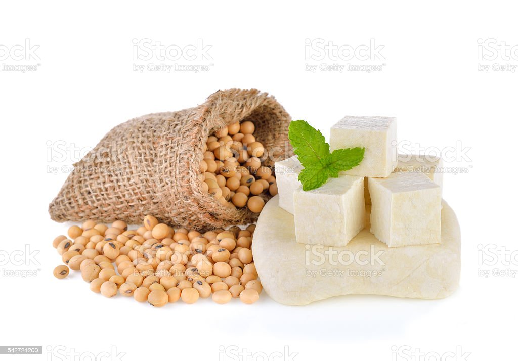 tofu cubes and soybean on white background stock photo