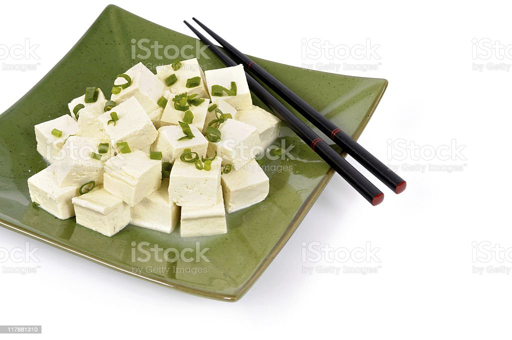 Tofu cubes with spring onion and chopsticks royalty-free stock photo