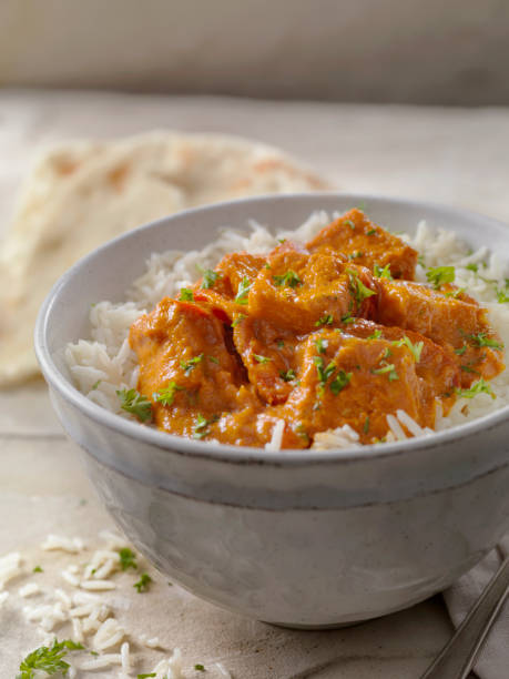 Tofu Curry with Rice and Naan Bread Tofu Curry with Rice and Naan Bread butter chicken stock pictures, royalty-free photos & images