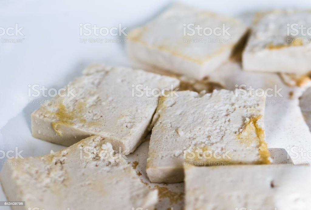 Tofu frying in ceramic pan stock photo