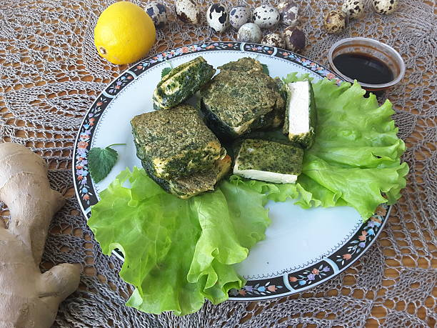 Tofu in green nettles tempura, on plate with lettuce stock photo