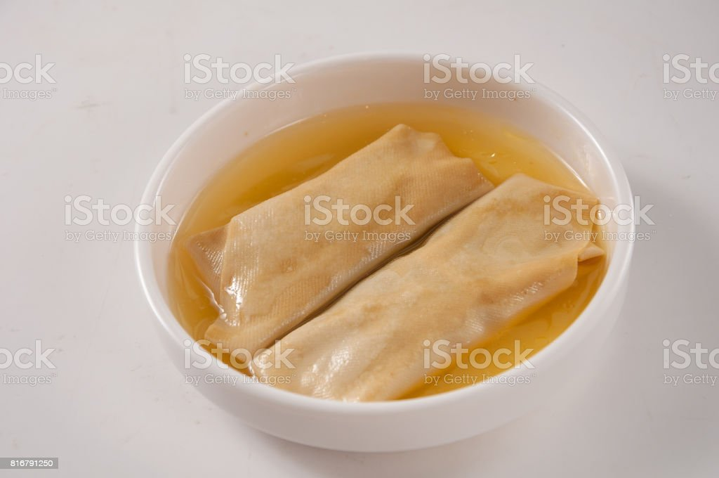 Tofu Skin Rolls with Minced Pork in Chicken soup stock photo
