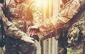 istock together collaborate of hands teamwork soldier 1202792295