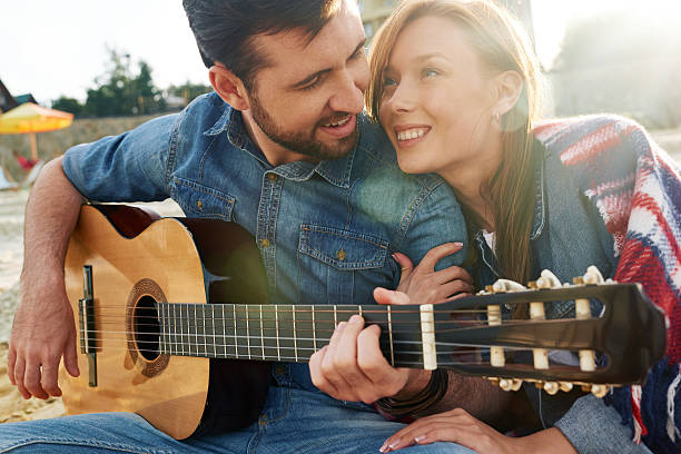 Together forever Romantic evening of beautiful couple serenading stock pictures, royalty-free photos & images