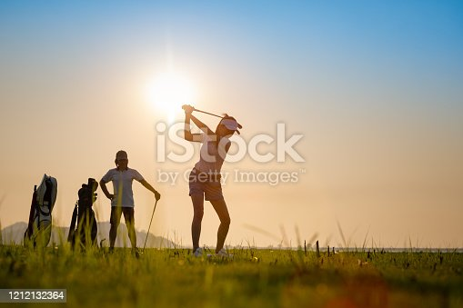 couple lover playing golf together in the course, try to keep golf ball away from the rough to fairway, difficult time stay together in the family concept