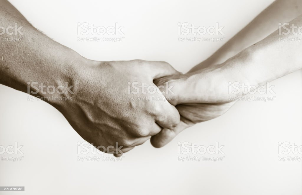 Together, helping hands. stock photo