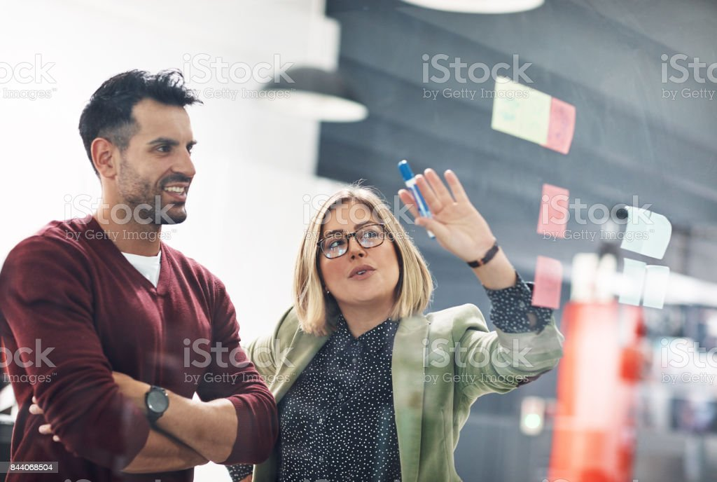 Together they discuss their strengths, weaknesses, opportunities and threats stock photo