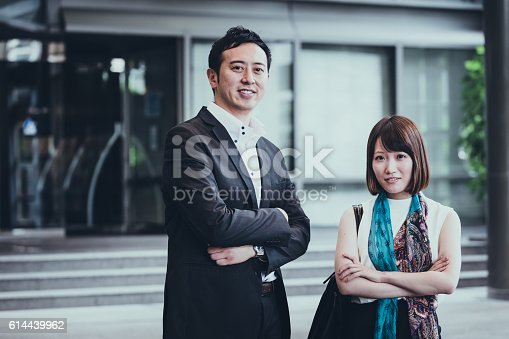 Portrait of a two young Japanese business executives.