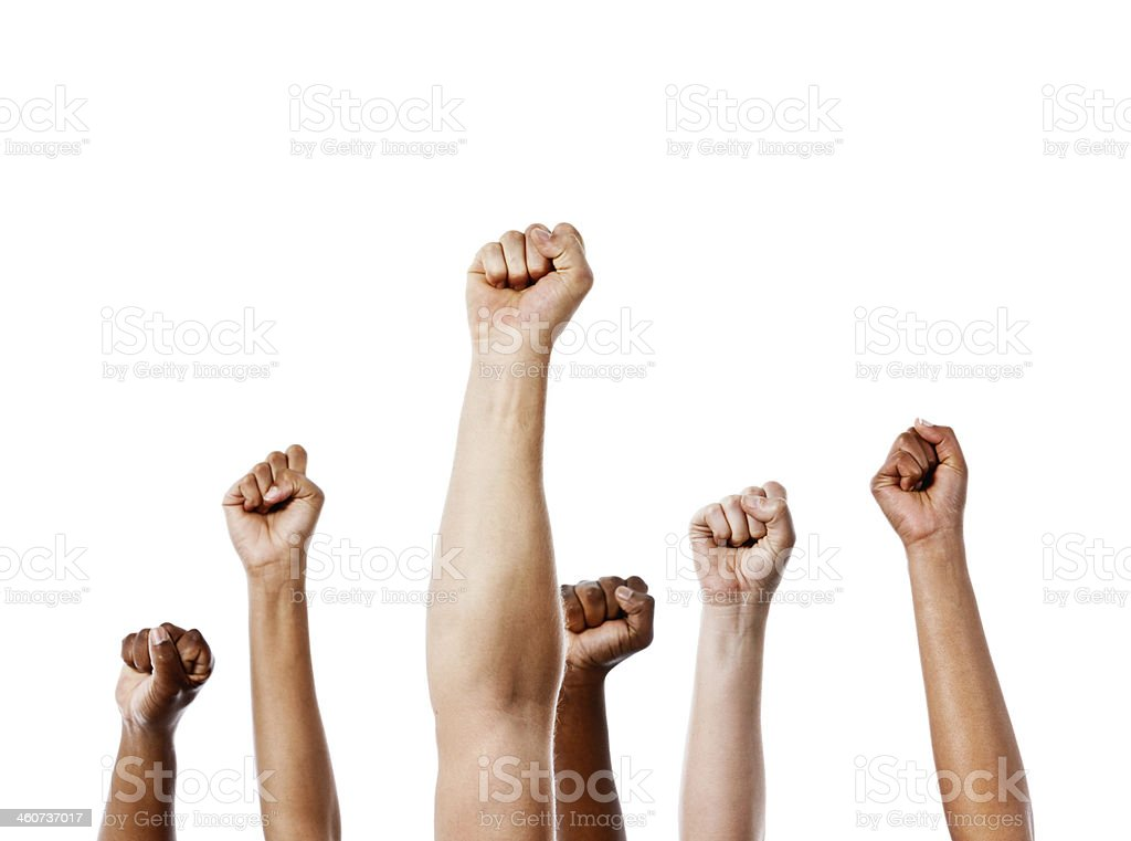 Together we stand! Many clenched fists punch air energetically stock photo