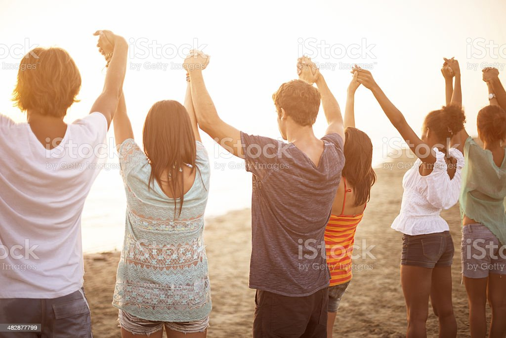 togetherness on the beach stock photo