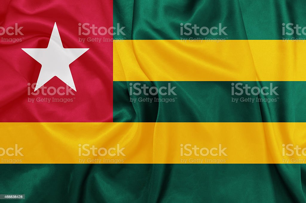 Togo - Waving national flag on silk texture stock photo