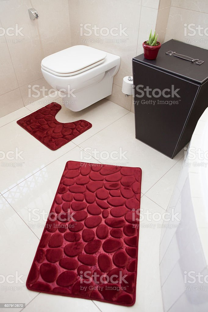 Toilet and luxurious bathroom mats stock photo