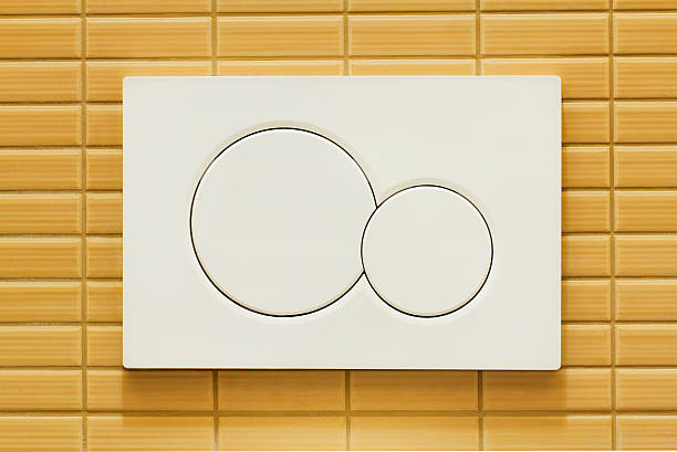 Toilet flushing buttons stock photo