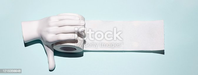 istock Toilet paper and hand. A concept on the theme of coronavirus 1215356648