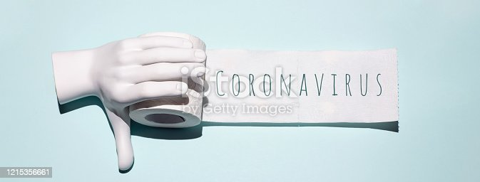 istock Toilet paper and hand. A concept on the theme of coronavirus 1215356661