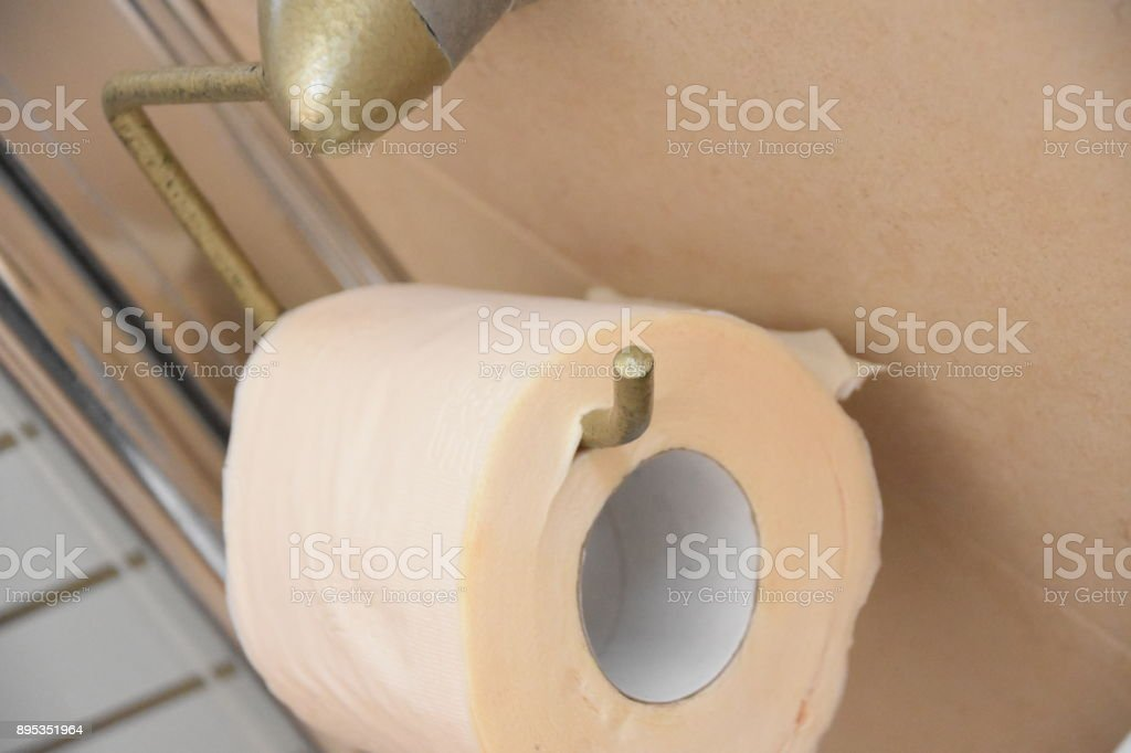 Toilet paper hung oddly stock photo