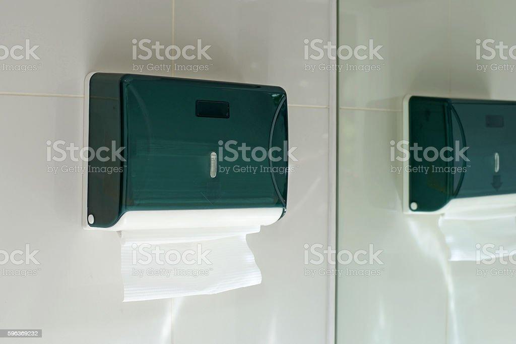 toilet paper in paper tower dispenser - foto de acervo