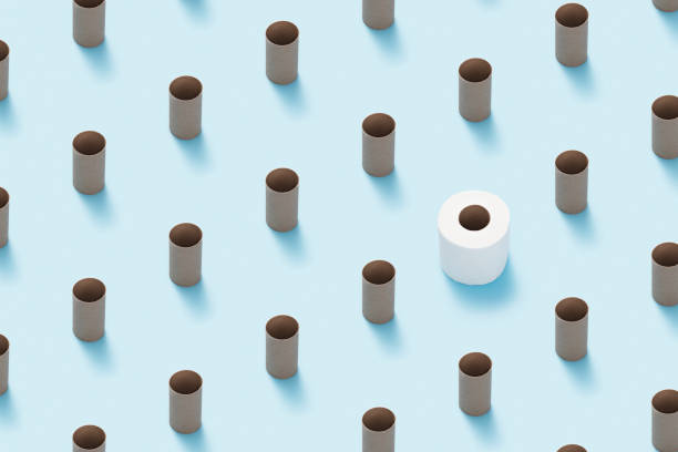 Toilet paper roll flat lay on blue background. stock photo