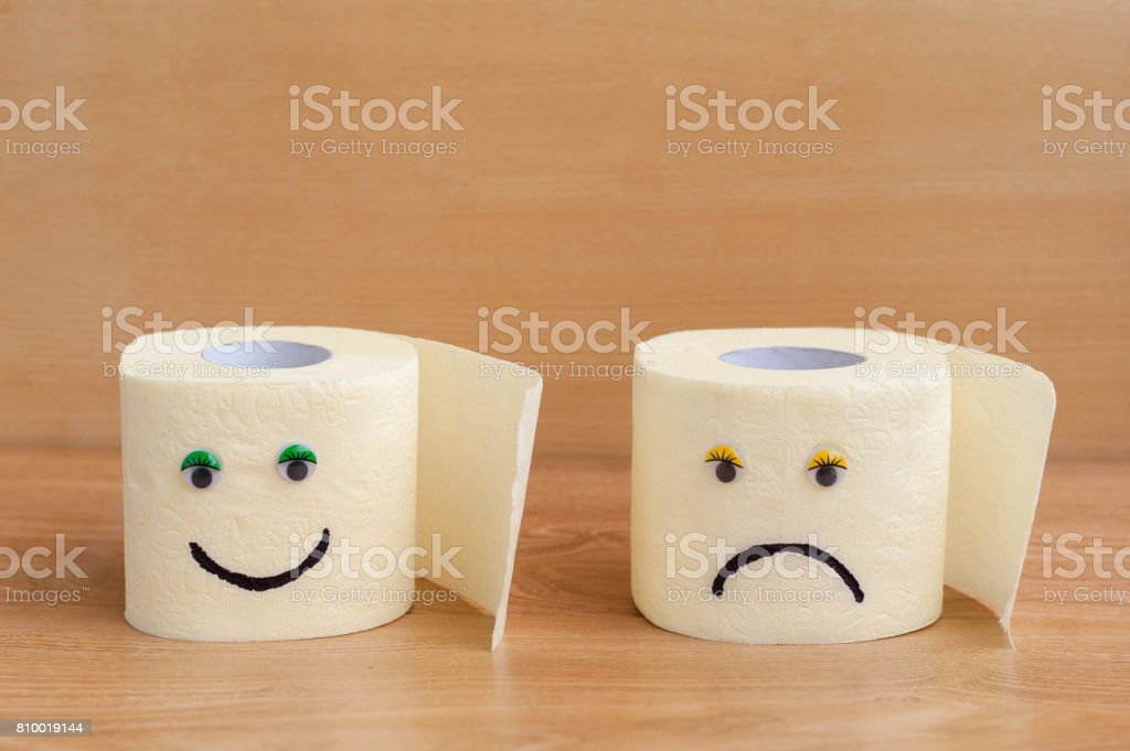 Toilet paper with googly eyes on wooden background. stock photo