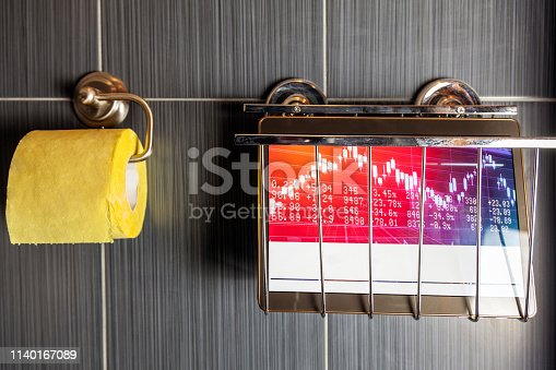 istock toilet papers and magazines on the wall, 1140167089