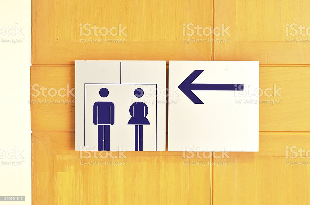 Toilet sign Toilet sign with arrow direction Adult Stock Photo