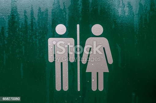 istock Toilet Sign Restroom, Mother room and Disabled sign green with silver figures 658270050