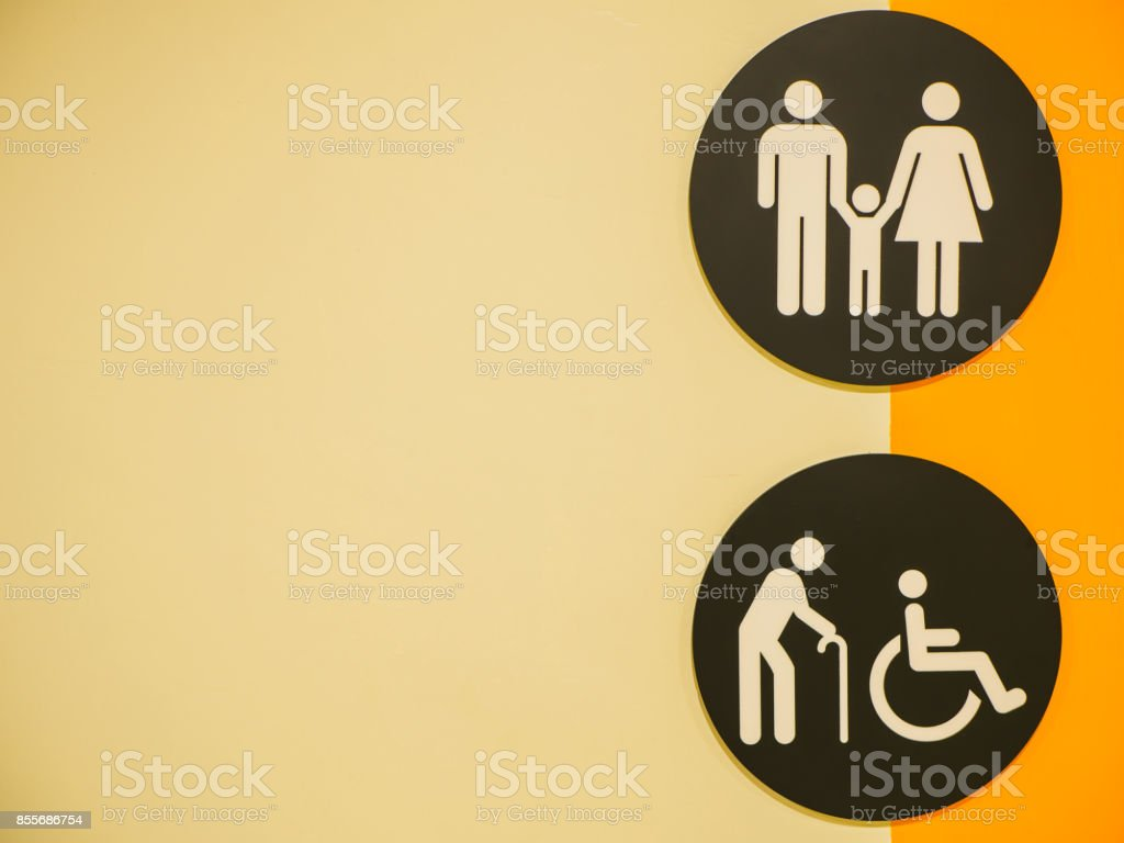 Toilets icon. Public restroom signs with a disabled access symbol on the wall in shopping mall. stock photo