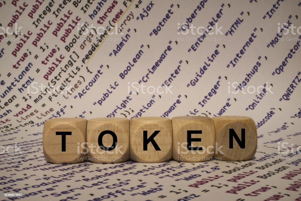 token - cube with letters and words from the computer, software, internet categories, wooden cubes stock photo