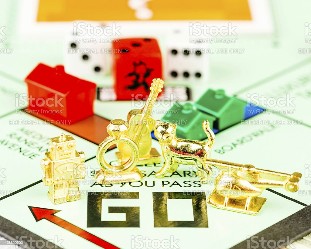 Tokens on Monopoly Board stock photo