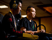 "Sacramento, CA, USA – March 27, 2016: Hajime ""Tokido"" Taniguchi  focuses on playing against Seonwoo ""Infiltration"" Lee of Team Razer in the Semifinals of Street Fighter V (5) on PS4 at NCR NorCal Regionals 2016."
