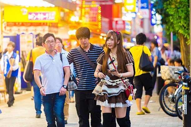 tokyo akihabara french maid outfit cafe customers - tokyo cosplay stock-fotos und bilder