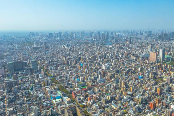 tokyo and odaiba skyline - urban sprawl stock photos and pictures