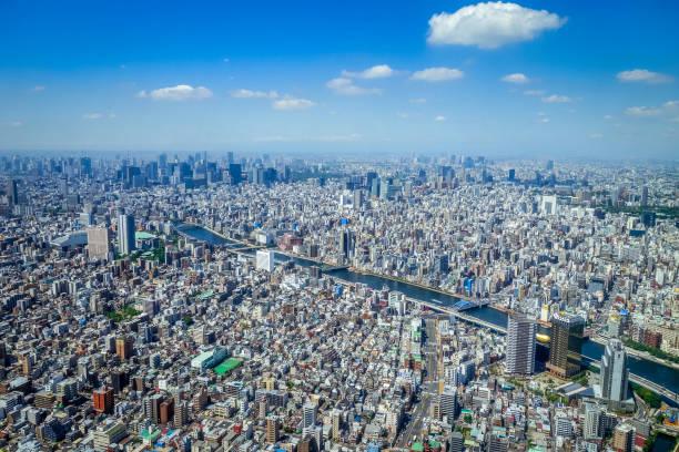 tokyo city skyline aerial view, japan - urban sprawl stock photos and pictures